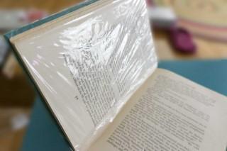 plastic wrap that book!